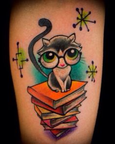 Sweet kitty bookworm tattoo for a couple by Karly Cleary.  I SO need to get this tattoo!