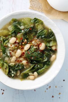 White Bean and Escarole Soup - escarole, garlic cloves, crushed red pepper, cannelloni beans, chicken/vegetable stock, sea salt & pepper, olive oil, grated pecorino romano cheese (optional)