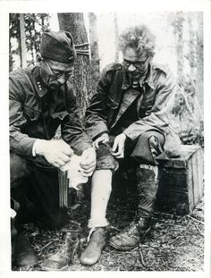 1941- Soviet doctor applies bandage to the leg of a wounded Finnish prisoner somewhere in the northern theater of war.
