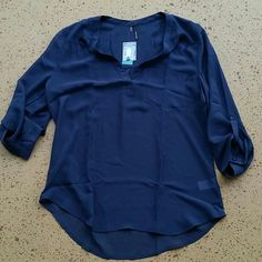 """NWT Maurices Vneck Sheer Top New with tags, Maurices Navy Blue Sheer Top. 100% Polyester. Laying flat, from top of shoulder to bottom of shirt is approximately 26"""" long. Across chest from armpit to armpit is approximately 21"""". No rips, tears, flaws, or defects. Comes from a smoke free home. Maurices Tops Blouses"""