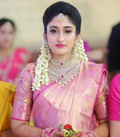 south indian bride in a pink silk saree and bridal diamond jewelry necklace with a ruby touch Indian Bridal Fashion, Indian Wedding Outfits, Bridal Outfits, Indian Weddings, Wedding Saree Blouse Designs, Pattu Saree Blouse Designs, South Indian Bride Hairstyle, Indian Bridal Hairstyles, Bridal Silk Saree