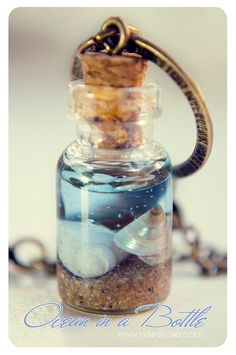 Ocean in a Bottle necklace. Vial necklace with Shells. mini Glass bottle necklace. shell Bottle Pendant. Sea bottle miniature. �11.99, via Etsy.
