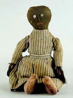 Original clothing on early black rag doll