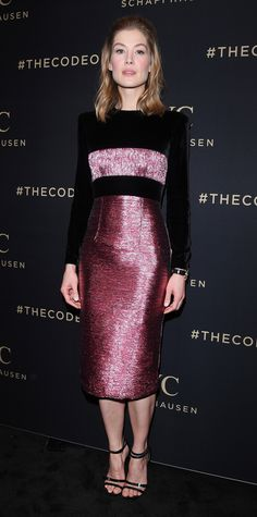 Rosamund Pike refracted light at the launch of the Da Vinci Collection by IWC Schaffhausen with a playful number that boasted a high-shine metallic pink bandeau and matching pencil skirt anchored by black velvet. The star completed her mixed-textured look with an IWC watch and black strappy sandals.