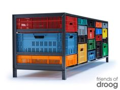 Second-hand crates get a second life as drawers in steel frames. Such cabinets vary (and are one-of-kind) based on supply of crates. Pretty cool.
