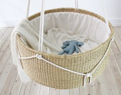 "A bassinet, bassinette, or cradle is a bed specifically for babies from birth to about four months, and small enough to provide a ""cocoon"" that small babies find comforting. Hanging Bassinet, Hanging Cradle, Bedside Bassinet, Cradle Bedding, Hanging Beds, Baby Bassinet, Baby Nursery Bedding, Baby Cribs, Baby Bedroom"