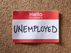 Name tag with unemployed written on it - William Andrew/Photographer's Choice RF/Getty Images