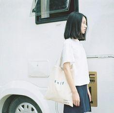 Hair, tote bag and white shirt