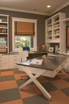 Central table on wheels: interesting thought.--love this office/craft room..not the colors tho