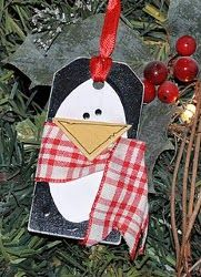 A Penguin Gift Tag is a great way to top off a gift! Use a wooden tag and some paint to create a unique piece that's perfect for the holidays. People might even like this tag more than the gift itself!