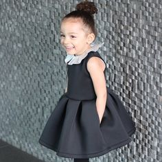 All smiles today in this gorgeous neoprene dress by @mingoandgrace. She added a @hucklebones top underneath to create a collar. Such a little fashionista.