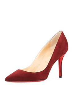"""Christian Louboutin suede pump. 3.3"""" covered heel. Pointed toe. Low-cut vamp. Slip-on style. Calf leather lining. Signature red leather sole. """"Apostrophy"""" is made in Italy."""