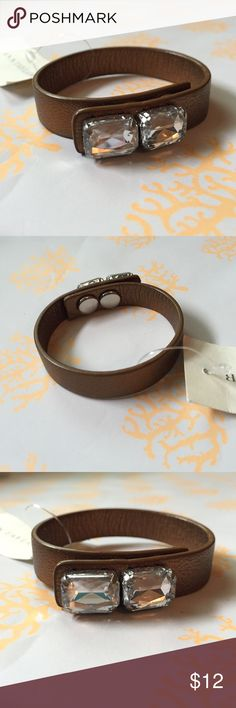 """NWT Ann Taylor leather bracelet NWT Ann Taylor bronze colored leather bracelet with two clear rectangular gemlike stones.  Snap closure makes it adjustable.  Measures 8 1/4"""" end to end.  The slightly metallic band is 1/2"""" wide and each of the gemlike stones measure 1/2"""" wide.  Great to wear alone or makes a nice layering piece. Ann Taylor Jewelry Bracelets"""
