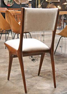 Set of Eight Carlo de Carli Dining Chairs | From a unique collection of antique and modern chairs at https://www.1stdibs.com/furniture/seating/chairs/