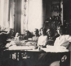 Maria N (left) Olga Alexandrova, Olga N (far right) with officers. But where? Looks like a reception room in a palace. Note walls. Probably AP.