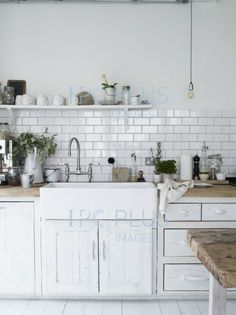 White subway tile is a classic touch to add to a kitchen or bathroom. This rustic kitchen is very simple, the clean white tile as the back splash is a great contrast to the rough wood counter tops. Updated Kitchen, New Kitchen, Kitchen Dining, Natural Kitchen, Kitchen White, Kitchen Tiles, Kitchen Sink, Kitchen Interior, Butcher Block Countertops