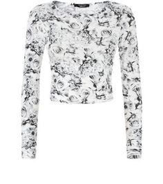 Teens. For a chic party look, team this monochrome floral crop with a block colour skater skirt and heels.- Simple long sleeves- Scoop neckline- All over print- Stretch fabric