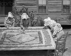..ladies stitching a quilt