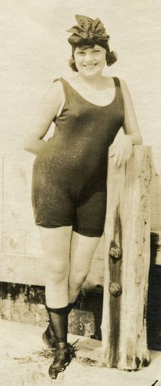 This gorgeous, curvey 1920s flapper shows how its done, in her Annette Kellerman style swimsuit and rolled stockings.