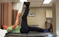 Learn easy physical therapy exercises to stretch tight hamstrings.: The Towel Hamstring Stretch