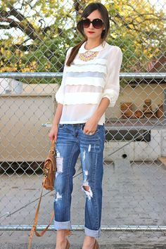 sheer scalloped blouse + distressed boyfriend jeans.