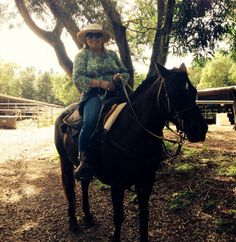 Grammy ridding horse in Maui