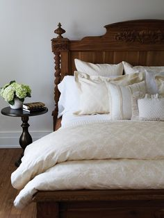 Beautiful bedroom, beautiful bedding.  Custom pale yellow and white bedding with fabrics from both Primavera and Kravet.