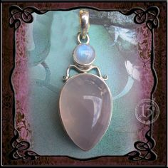 Rose quartz Drop with moonstone. Sterling silver pendant. Such a beautiful piece of jewellery.