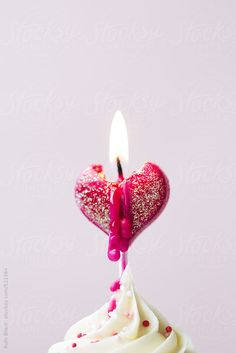 Valentine cupcake with candle by RuthBlack | Stocksy United