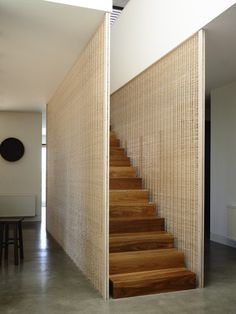 woven walls, wooden stairs