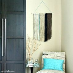 This DIY Yarn Wall Hanging is easy to create and adds a lovely, soft touch to any room. Makes for a unique statement piece for your wall.