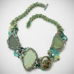 http://dvinedzines.com/wp/wp-content/uploads/2012/03/Kerry-Vine1208.jpg -  freeform - This oceanic necklace has pottery that has been washed in the Pacific for many years, as well as a beautiful piece of Labradorite, and some fresh water pearls.