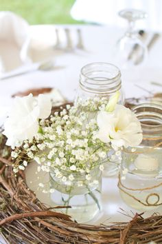 grapevine, baby's breath, & mason jar wedding centerpieces.i fell like these would be good for cocktail hour, but i prefer the taller center pieces when you have bigger tables to eat at..