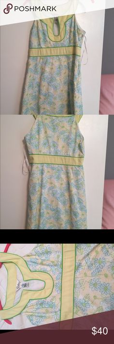Lilly Pulitzer Dress Adorable white and yellow spring and summer Lilly Pulitzer dress! This dress has only been worn by me once but I bought from another posher who wore it a handful of times. It is in great condition! Lilly Pulitzer Dresses