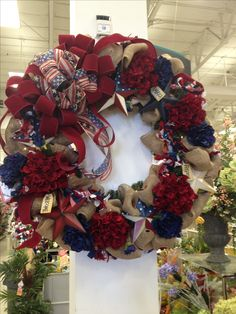 """Americana 36"""" Wreath. Red White And Blue Collection 2013. I designed this piece to be enjoyed all year long even for Christmas. Design by Christian Rebollo"""