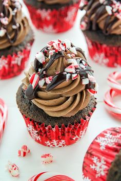 Supremely moist and decadent chocolate cupcakes topped with peppermint mocha frosting, a drizzle of chocolate ganache, and crushed candy canes. cupcakes Peppermint Mocha Chocolate Cupcakes - Baker by Nature Peppermint Cupcakes, Mocha Cupcakes, Holiday Cupcakes, Peppermint Mocha, Holiday Desserts, Holiday Baking, Christmas Baking, Christmas Cupcake Flavors, Holiday Parties