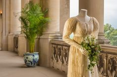 """The wedding costume worn by Trevyn McDowell in """"Middlemarch"""" is a one-piece dress of deep cream, net-embroidered with flowers over cream silk and trimmed with blonde lace. The attached belt is of cream-striped silk."""