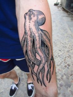 boy with line work black octopus forearm tattoo