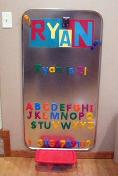 Oil Drip Pan used as Magnet Board for 2-year-old's toyroom