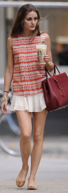 Who made  Olivia Palermo's white chiffon pleated skirt and red handbag that she wore in New York?