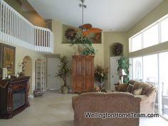 Grand Isles Pool Home for Sale in Wellington Florida Under $400,000. Gorgeous pool home for sale featuring 5 bedrooms, 3 bathrooms and a 3 car garage.
