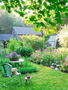 A casual cottage garden.  Glass cloches are used to shield plants from cool, early-season temperatures, but later in the year, they provide an interesting hardscape element for a garden.