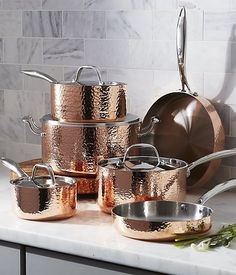 Create your dream copper kitchen with our Fleischer and Wolf Hammered Copper Cookware Set. This extraordinary copper cookware set shows off beautifully in the kitchen, featuring gleaming copper exteriors textured with artisanal-like hammering and elegant stainless steel handles.
