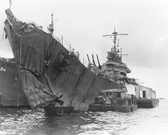 USS St. Louis (CL-49) after the Battle of Kolombangara, showing torpedo damage to her bow during WWII.  The St. Louis, the lead ship of her class of light cruisers, was the fifth ship of the United States Navy named after the city of St. Louis, Missouri. Commissioned in 1939, she was very active in the Pacific during World War II, earning eleven battle stars.  She was deactivated shortly after the war, but was recommissioned into the Brazilian Navy as Almirante Tamandaré in 1951.