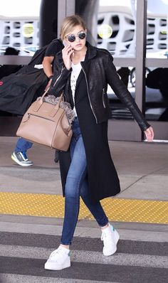 Gigi Hadid slays the layers with this leather jacket + duster cardigan combo.