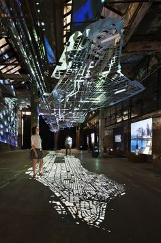 Light projected through a reverse cut map and displayed on the floor. Experiments In Motion #istallazioni #design #luci