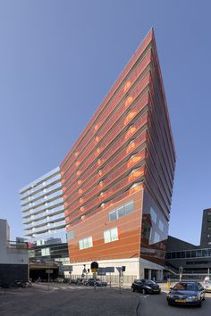 Designed by Gigon/Guyer, the trapezoid-shaped Almere Residential Building is wrapped entirely in glass making it look sleek and striking. Architecture Building Design, Modern Architecture, Gigon Guyer, Architectural Photographers, Amazing Buildings, Postmodernism, Landscape Photos, Building A House, Skyscraper