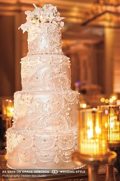classic iridescent pearl white wedding with delicate piped design