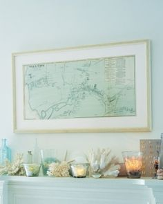 Create a walk-on-the-beach feel on your mantelpiece by hanging a nautical map above a collection of found objects and antiques like sea glass in votive holders along with coral, shells, sand dollars, and vintage glass bottles.