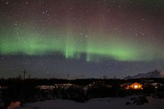 Northern Lights in a straight green line across the sky over Myvatn, Iceland
